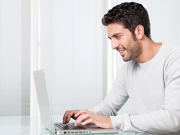 A young man at his laptop